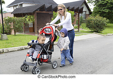 Lovely Mother with Her Children, Mums with strollers in the...