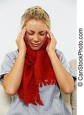 Young blond sick woman with headache