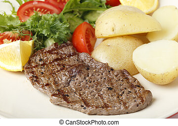 Minuted steak meal - Pan-grilled pepper minute steak served...
