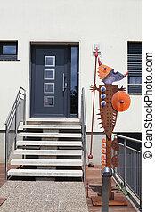 Log home. - Log home closeup decorated unique figure of...