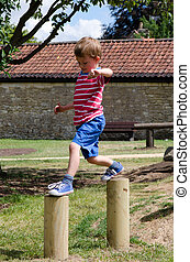 Young boy playing in a playground - Young boy playing and...