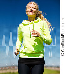 smiling woman jogging outdoors - fitness, sport, training...