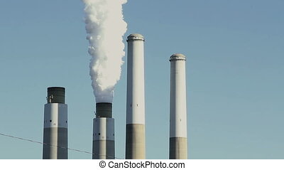 Smoke stacks, vintage look - Greenhouse gases billow from...