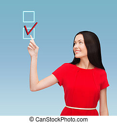 young woman in red dress pointing her finger - education and...
