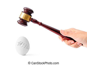 Law concept - Gavel about to crush an eggshell stiched...