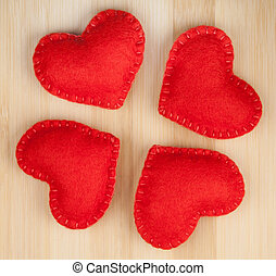 Red hearts - Small red hearts on a wood background