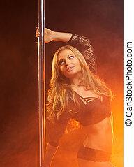 Portrait of a beautiful sensual female dancer smiling -...