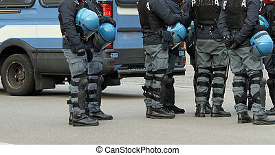 policemen with bullet-proof jacket and blue helmet during...