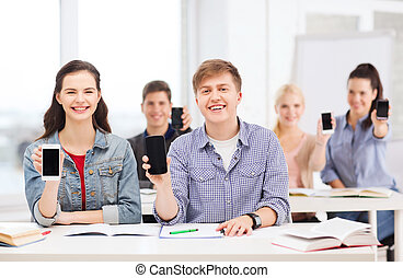 students showing black blank smartphone screens - education,...