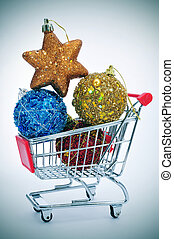christmas ornaments in a shopping cart - a pile of christmas...
