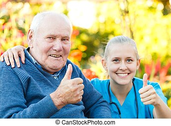 Thumbs up for nursing homes - Happy elderly patient with...