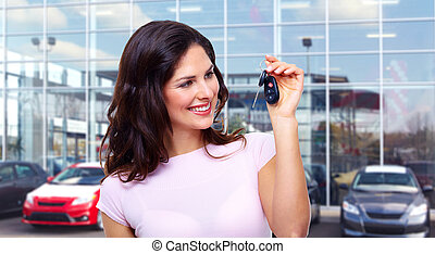 Beautiful woman with a car key - Beautiful young woman with...