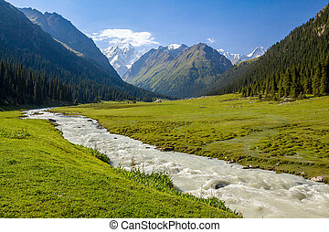 Mountain ridge and rapid river. Tien Shan, Kirgizstan