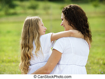 Mother and daughter hugging - Mother and teenage daughter...