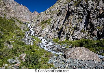 Cascade of river in Kirgizstan. Tien Shan mountains