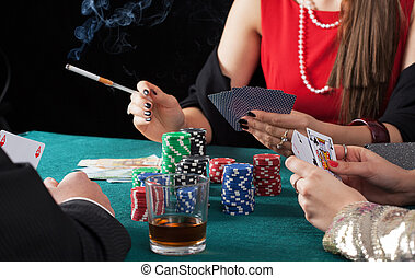Friends playing poker game - Friends with cards and chips...