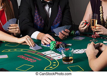Rich people gambling in casino, poker game