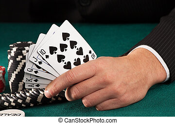 Man hand holding poker cards - Man hand on casino table...