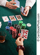 Cards, colorful poker chips and alcohol in casino