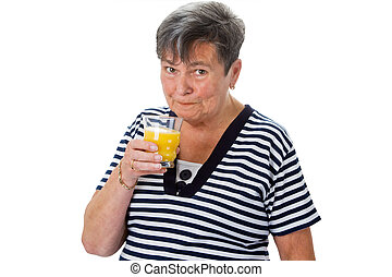 Elderly woman drinking orange juice