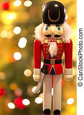 Nutcracker over christmassy bokeh background