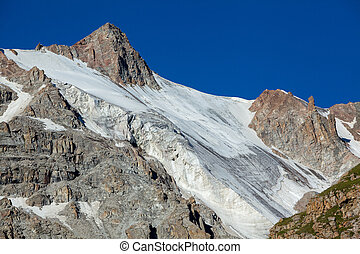 Mountain with ice slope. Tien Shan Mountains, Kyrgyzstan