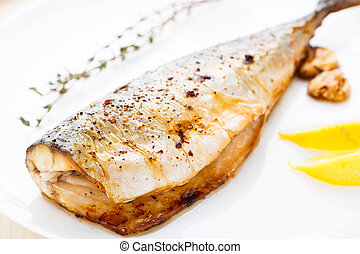 Baked mackerel - Delicious baked mackerel on a white plate