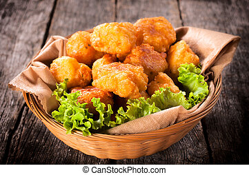 Potato croquettes - Homemade potato croquettes in the wooden...