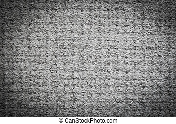 Gray carpet background. Textile texture. Light vignette