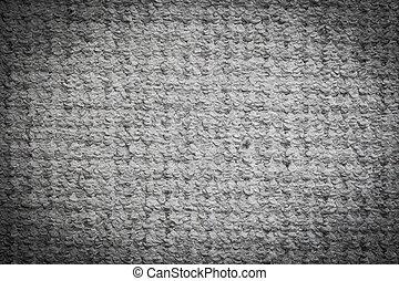 Gray carpet background. Textile texture. Light vignette