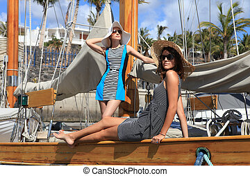 Girls on a yacht in the summer