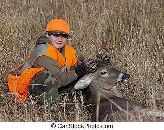 Youth Deer Hunting - A young boy with a deer