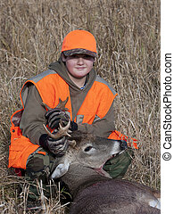 Youth Hunter - A youth with a deer