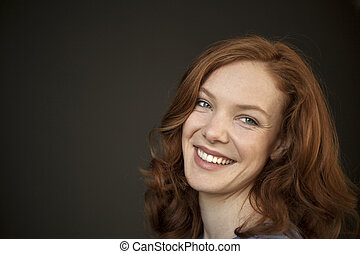 Young Woman with Beautiful Blue Eyes and Red Hair - Portrait...
