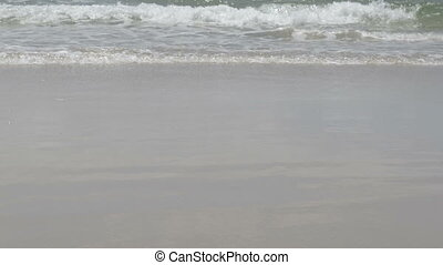 Waves Lapping Beach - Gentle small ocean waves lapping the...