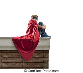 Superhero kid - Superhero kid sitting on a wall that...