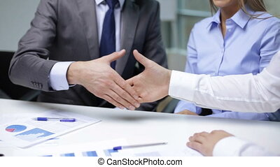 two businessmen shaking their hands - business handshake...