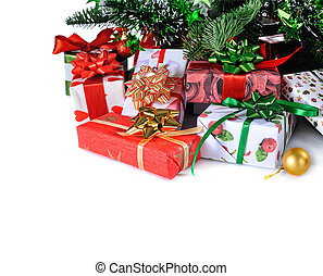 gifts under Christmas tree - gift boxes under decorated...