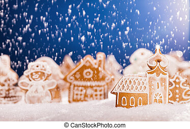 Christmas gingerbread with falling snow - Macro photo of...