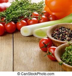 Fresh Organic Vegetables and Spices on a Wooden Background...