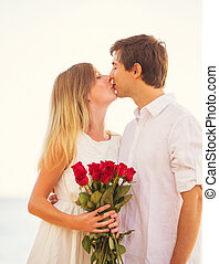 Young Couple in Love, Man giving beautiful woman bouquet of...