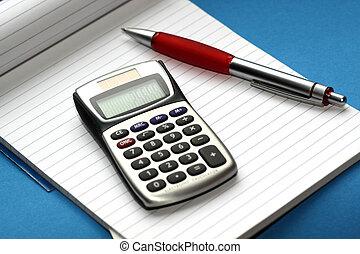 Calculating, noteblok and a pen