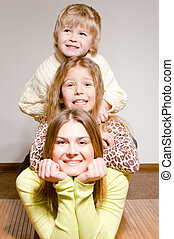 Three happy brother and sisters hug