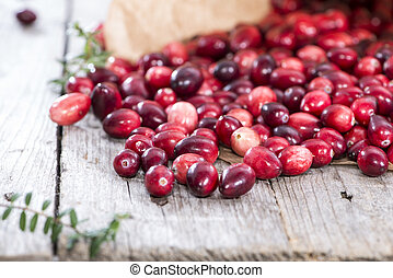 Heap of fresh Cranberries on vintage wooden background