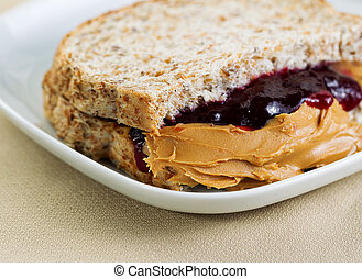 Tasty Creamy Peanut Butter and Jelly Sandwich - Closeup...