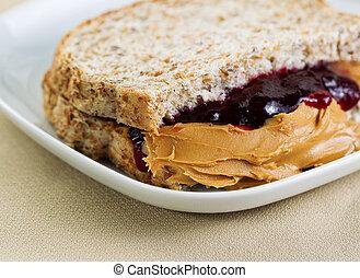 Tasty Creamy Peanut Butter and Jelly Sandwich - Closeup...
