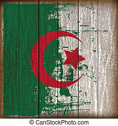 Grunged Algerian Flag over a wooden plank background...
