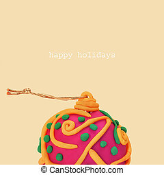 happy holidays - fancy christmas ball and the sentence happy...
