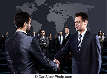 Portrait of young business people Handshake in front of...