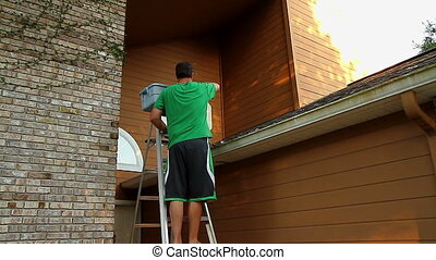 Cleaning Gutters - Adult Male Cleaning Gutters On Home